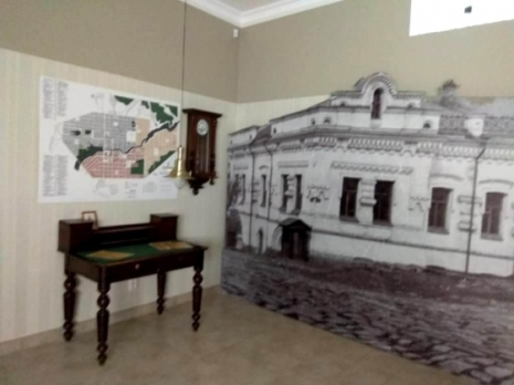 Image of the Ipatiev House and other exhibits on display